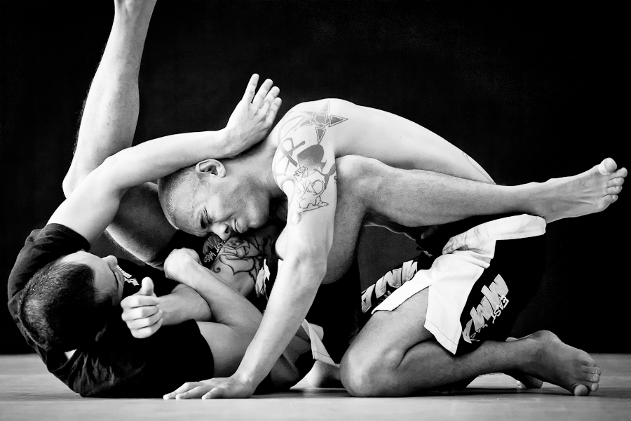 """Kelly Anderson coaches students in the brutal art of """"submission wrestling."""""""